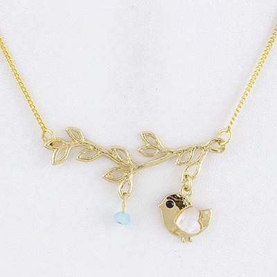 Gold bird on branch necklace