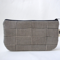 SCRAPPY CLUTCH IN STRIPED BASKETWEAVE