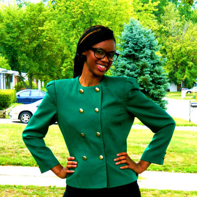 Green blazer with broad shoulders