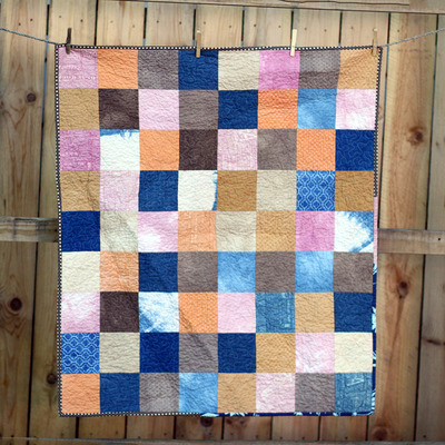 Hand-dyed patchwork baby quilt