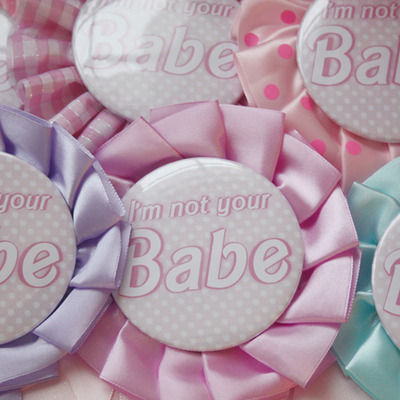 """i'm not your babe"" rosette pin"