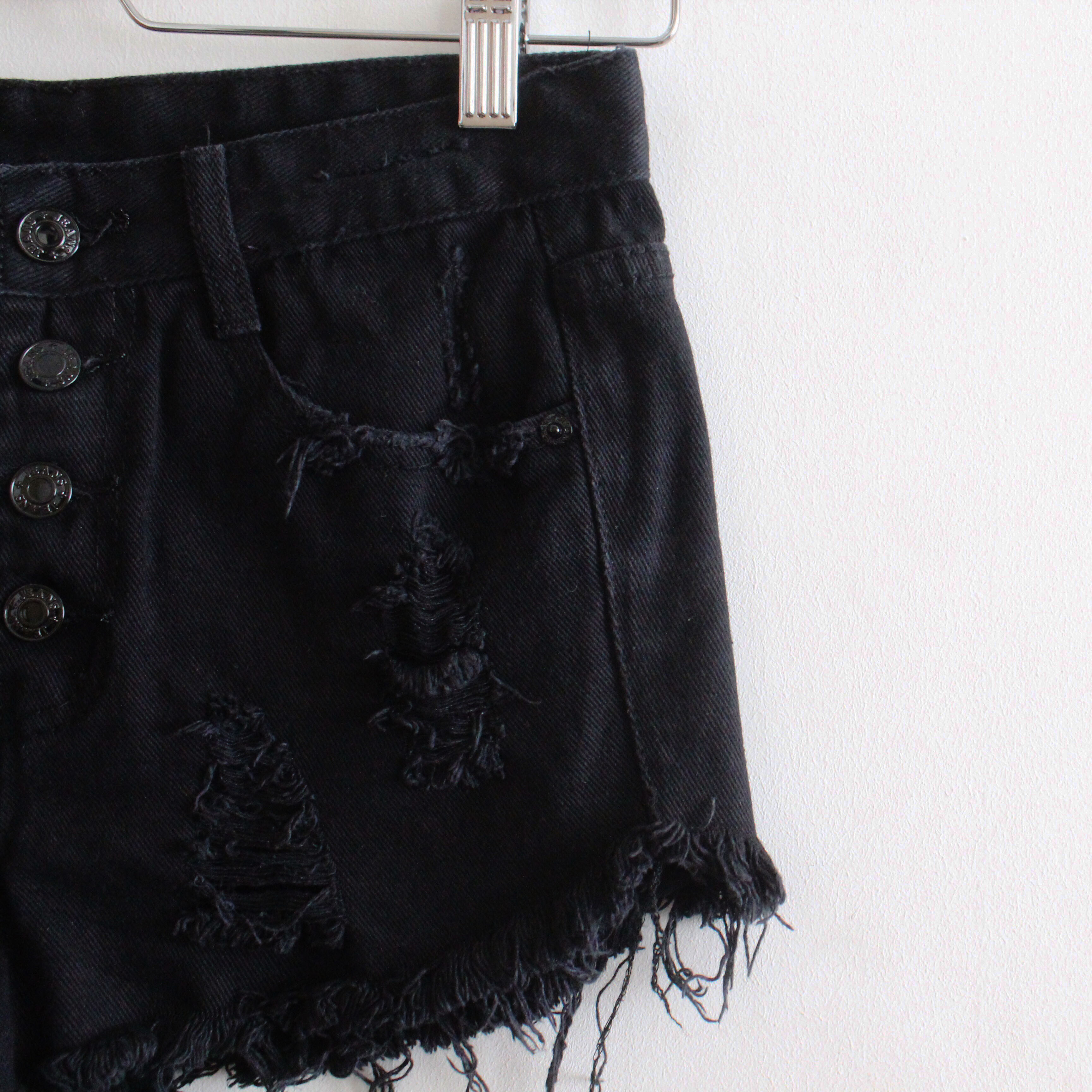 black ripped high waisted shorts