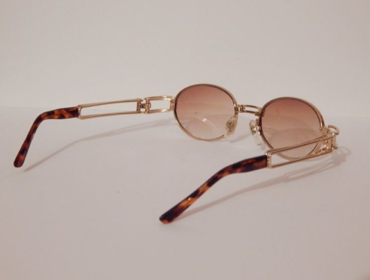 vintage gold oval gold frame sunglasses trill