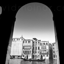 P020 Venice Gondola Through Pillars
