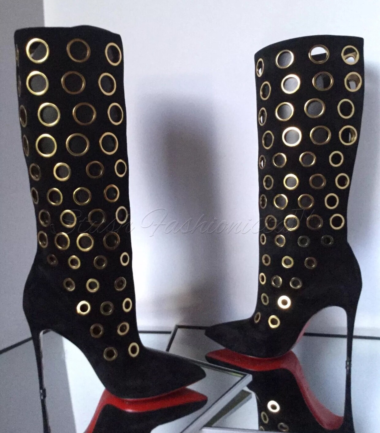 release date 6009c c0c2a Christian Louboutin: Apollo 100 Eyelet Boots from Stush Fashionista