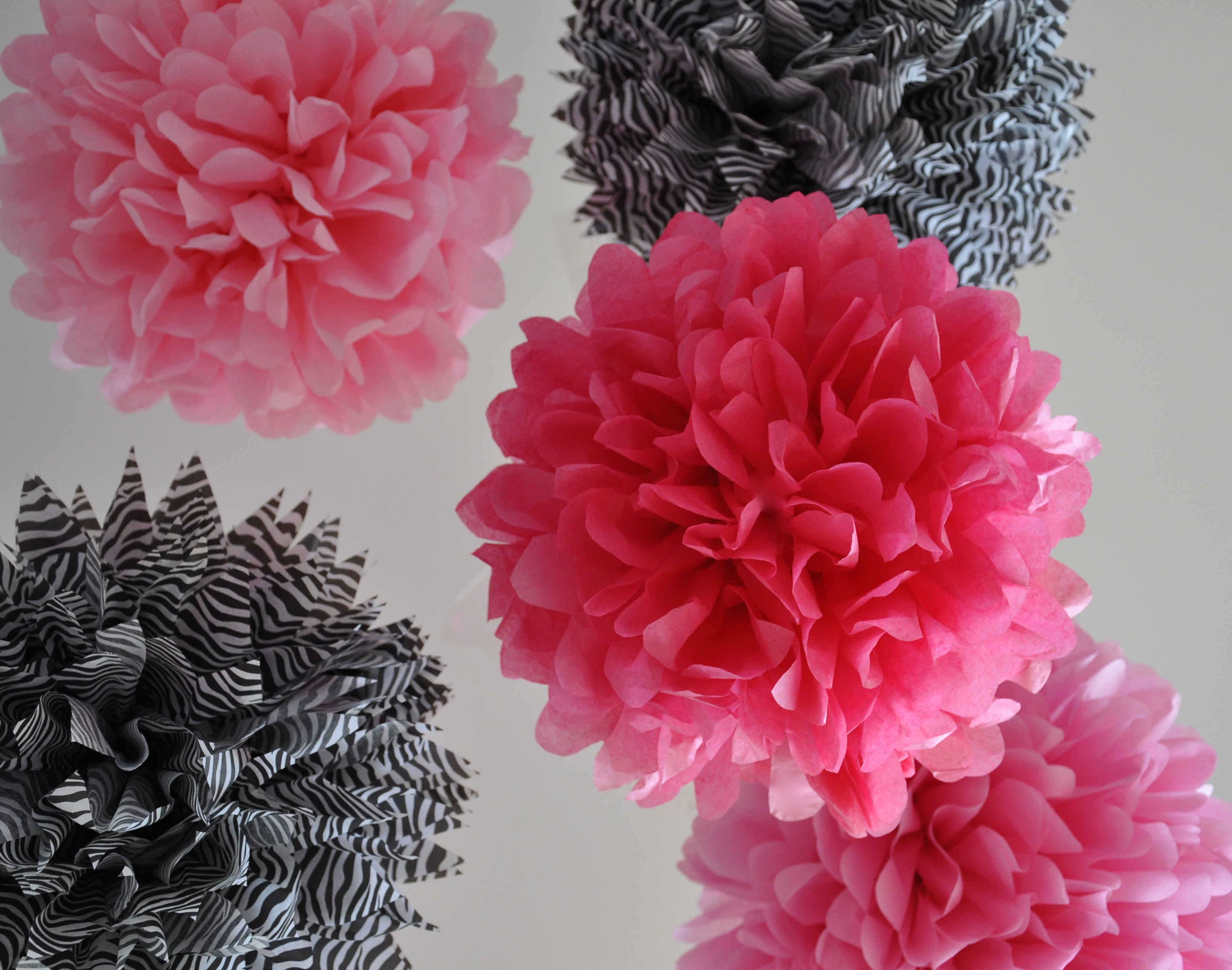 Blush Flower Hanging Tissue Paper Pom-Pom Decorations | Oriental Trading | 2848x3617